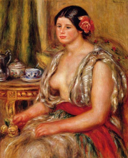 Девушка, сидящая в восточном костюме