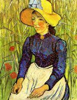 Молодая крестьянка в соломенной шляпе в пшенице