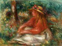 Девочка, сидящая на траве