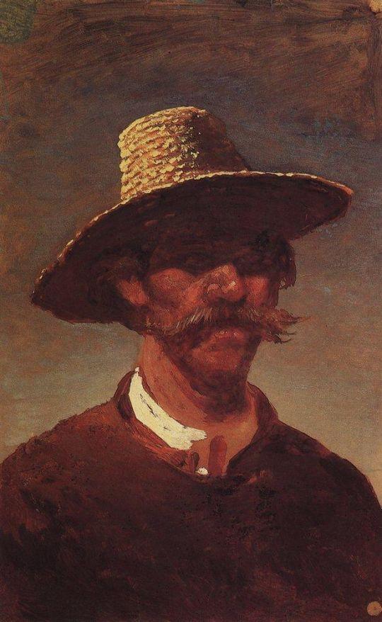 Голова крестьянина-украинца в соломенной шляпе.