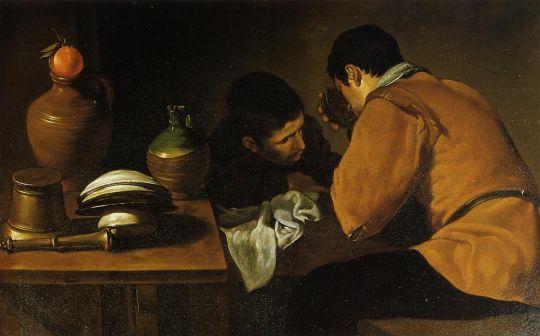 Двое молодых людей за столом