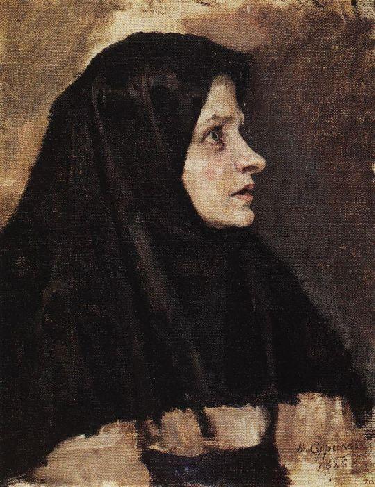 Голова женщины в черном платке