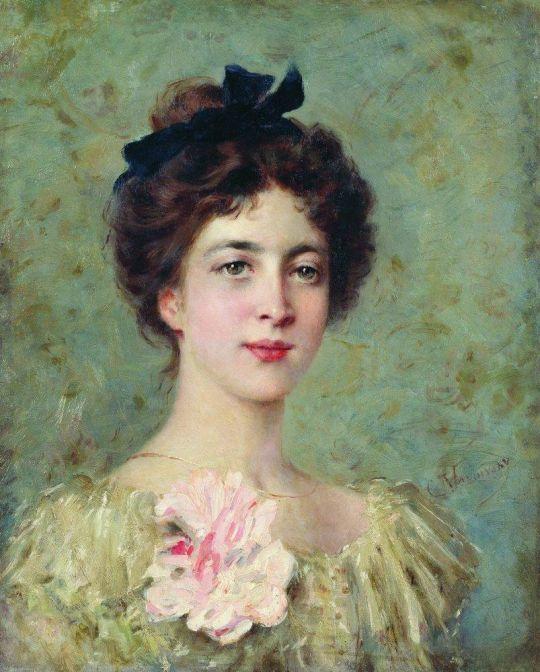 Портрет молодой девушки с розовым бантом