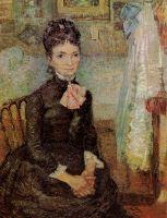 Женщина, сидящая у колыбели