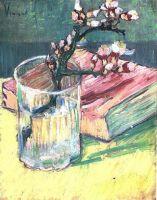 Ветвь цветущего миндаля в вазе и книга