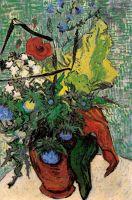 Полевые цветы и чертополох в вазе