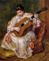 Женщина, играющая на гитаре