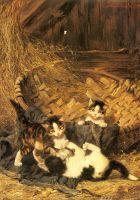 Котята, играющие в корзине