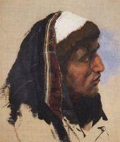 Голова молодого мужчины в синем покрывале