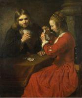 Молодой человек и девочка играют в карты