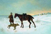 Охотник перед убитым волком