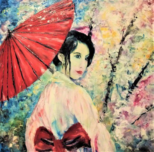 Японская девушка в цветущем саду